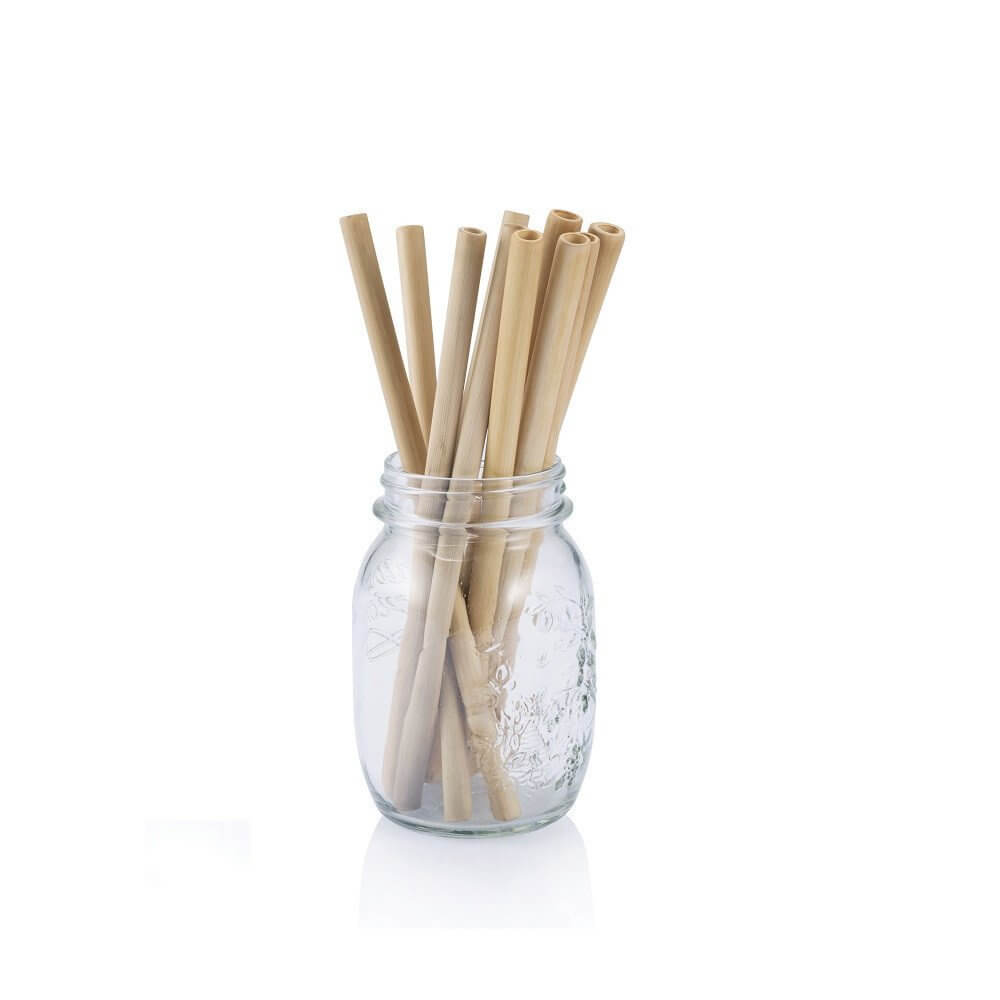 A glass jar with bamboo straws in it