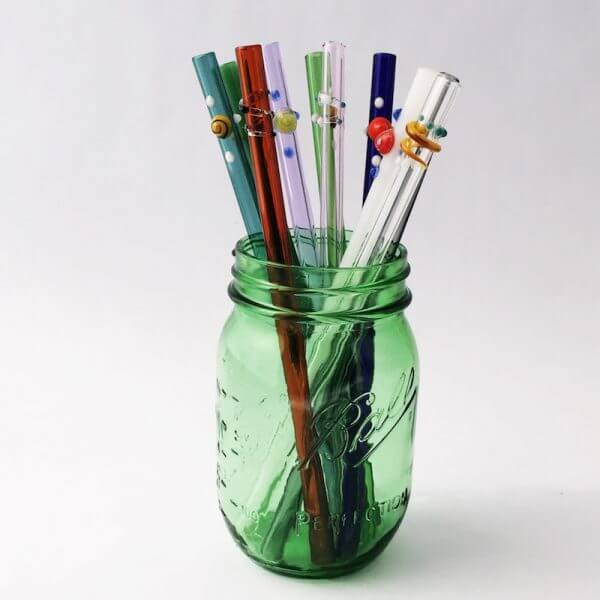 Glass straws in a green glass jar