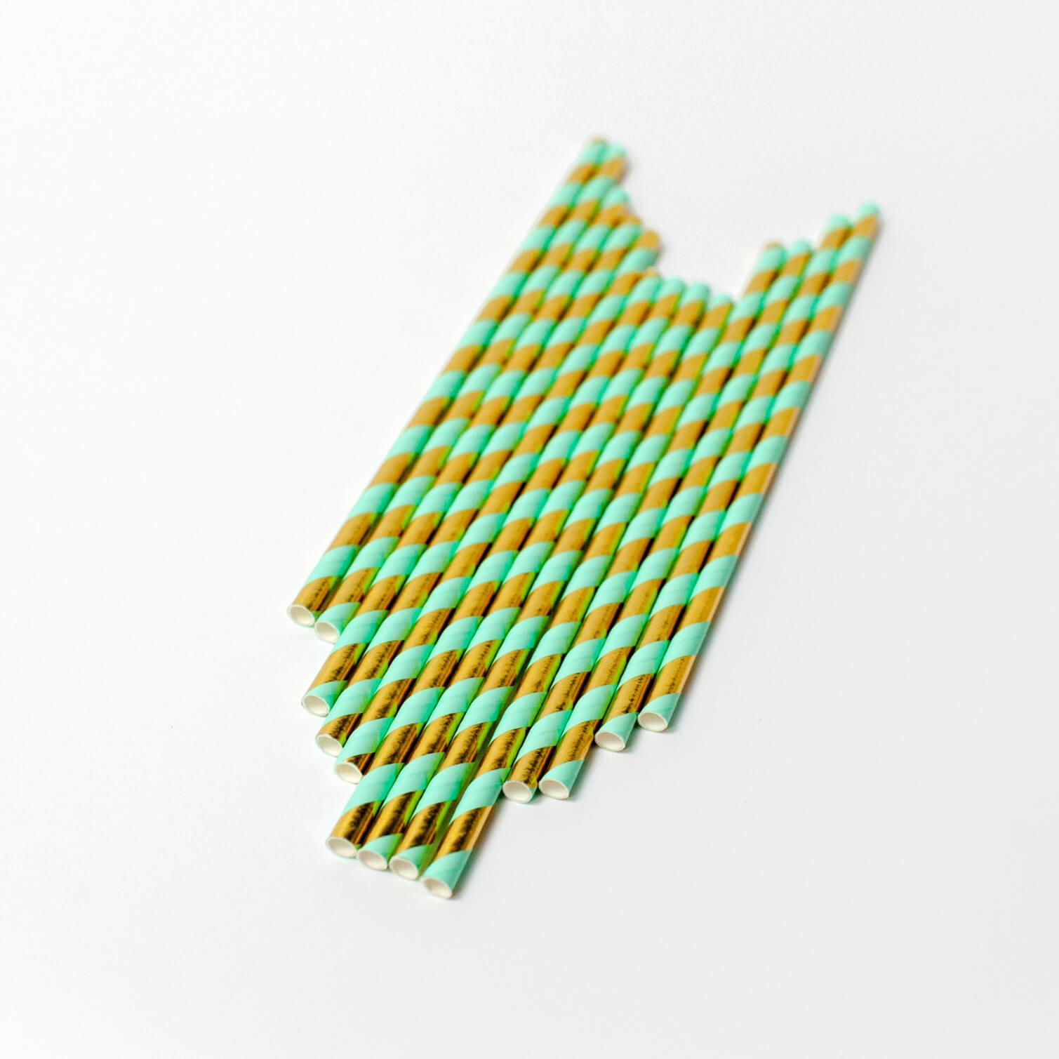 Green and gold paper straws