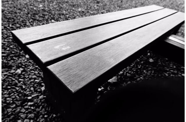 A plastic bench made out of recycled plastic.