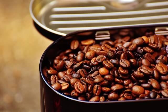 Coffee tin and coffee beans.