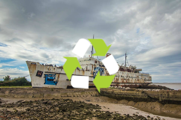 Ship pulled on the beach with a recycle logo