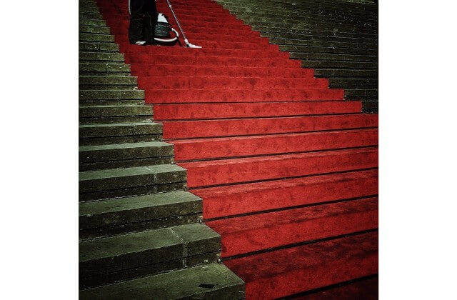 A red carpet on a set of steps.