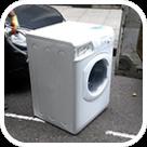 Washing machine waiting for disposal